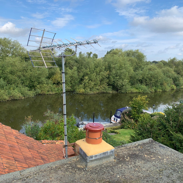 Chimney stack rebuild in Wraysbury with chimney cap and aerial re attached