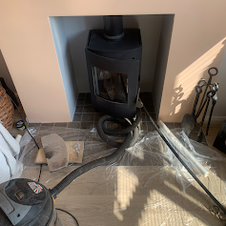 Chimney Sweeping a wood burning stove in