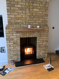 Old fireplace replaced with a wood burni