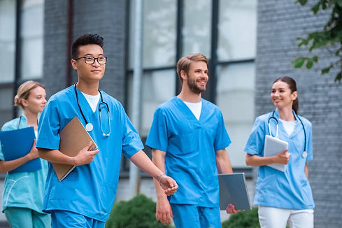 stock-photo-cheerful-multicultural-medical-students-walking_edited.jpg