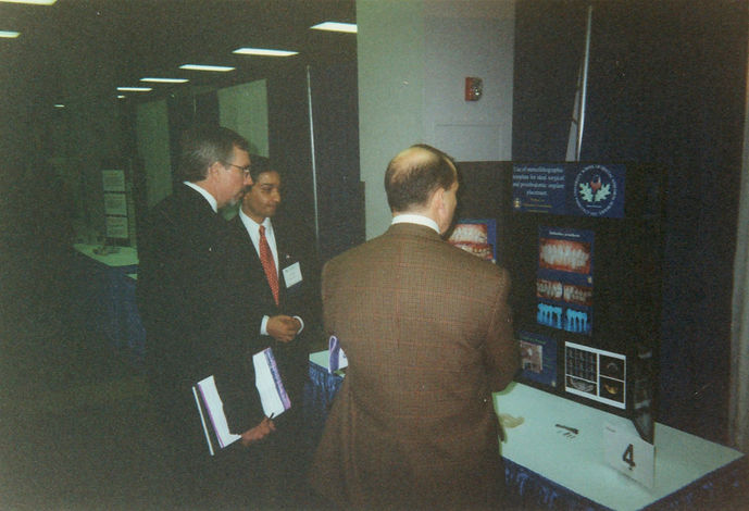 Dr. Patrick Lloyd reviewing Dr. Kunal Lal Table Clinic at ACP Annual Meeting 2001