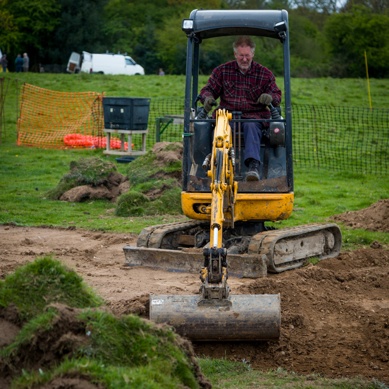 The mini-digger struggling with the hardness of the ground at the moment.