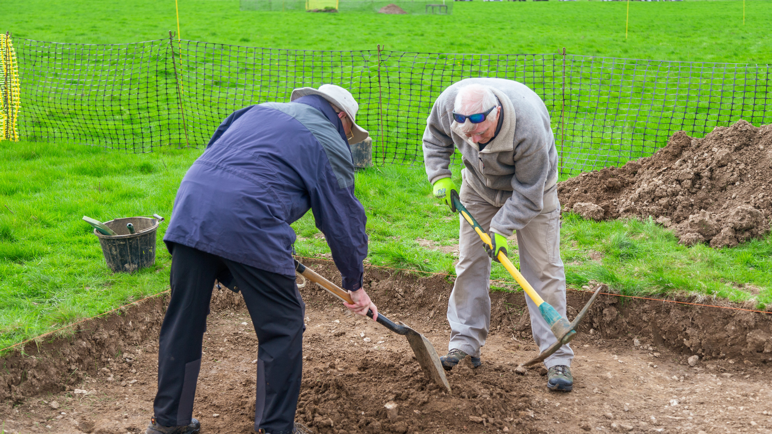 Peter and Tony levelling up the surface.
