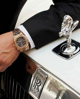 A rich man and a rolls royce