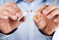 Quit smoking, human hands breaking the c