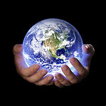 Man holding a glowing earth globe in his