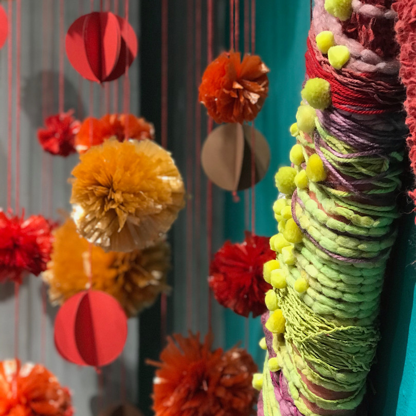 Raffia and paper pom poms, fabric and yarn wrapped foam