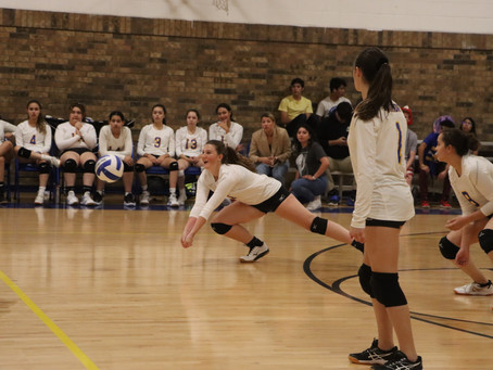 Varsity Volleyball Preps for District Against Jesus Chapel