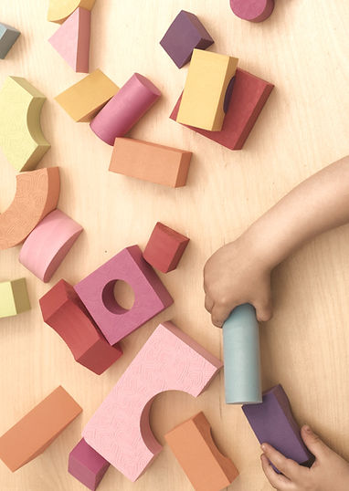 kids-playing-with-blocgk-toys_edited.jpg
