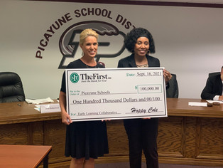 TheFirst makes donation to Early Childhood Program