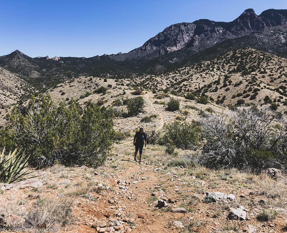 Hiking uphill in the Sandia Mountain Wilderness trails