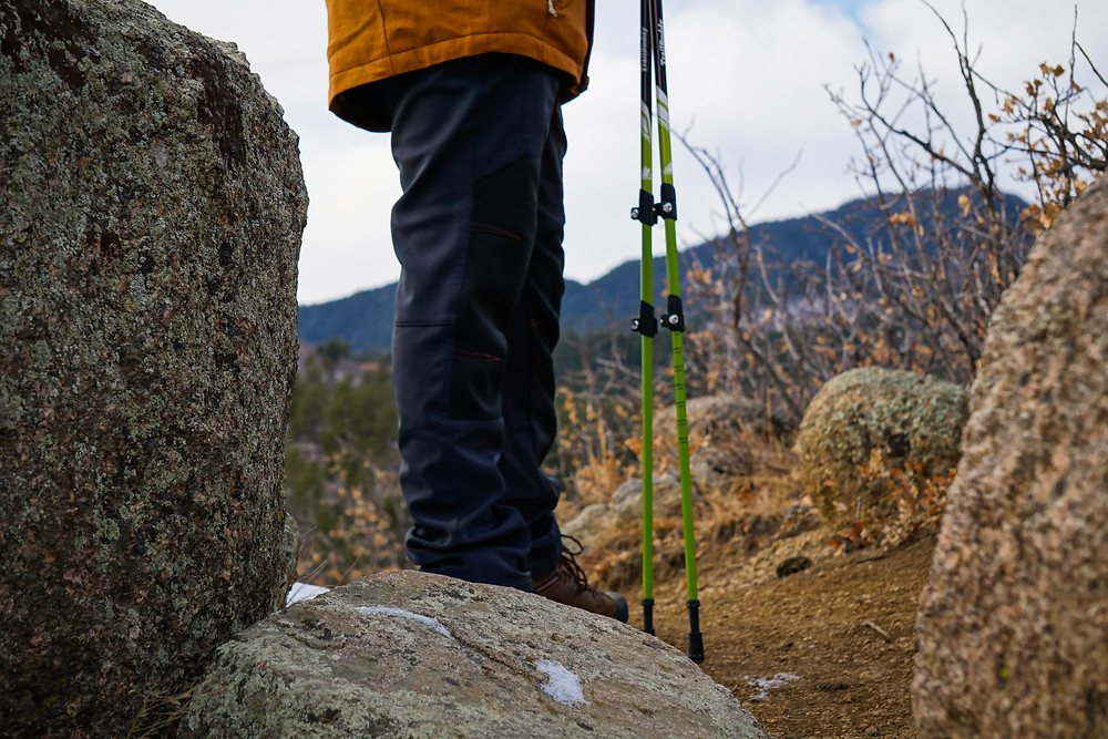Close up image of hiker's legs with trekking poles