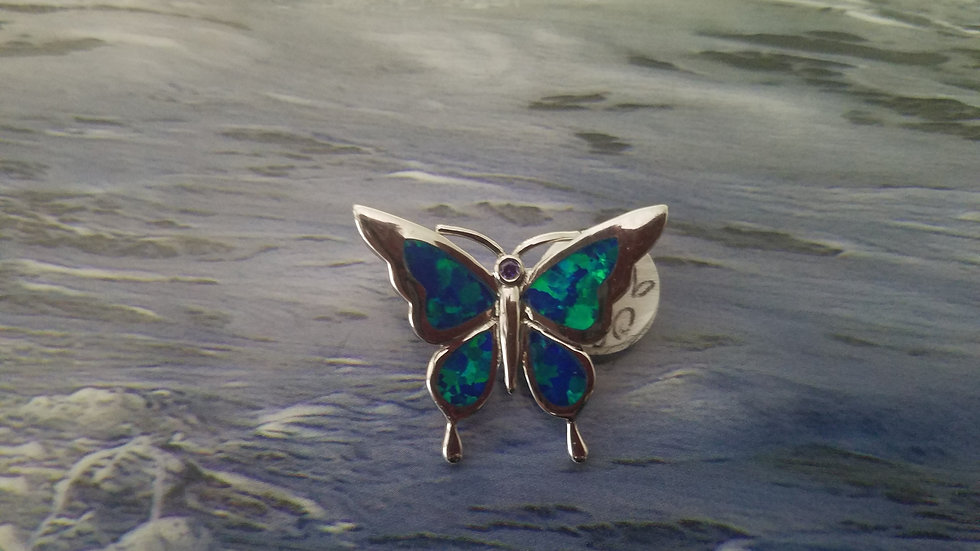 Butterfly pendant with inlaid man made opal