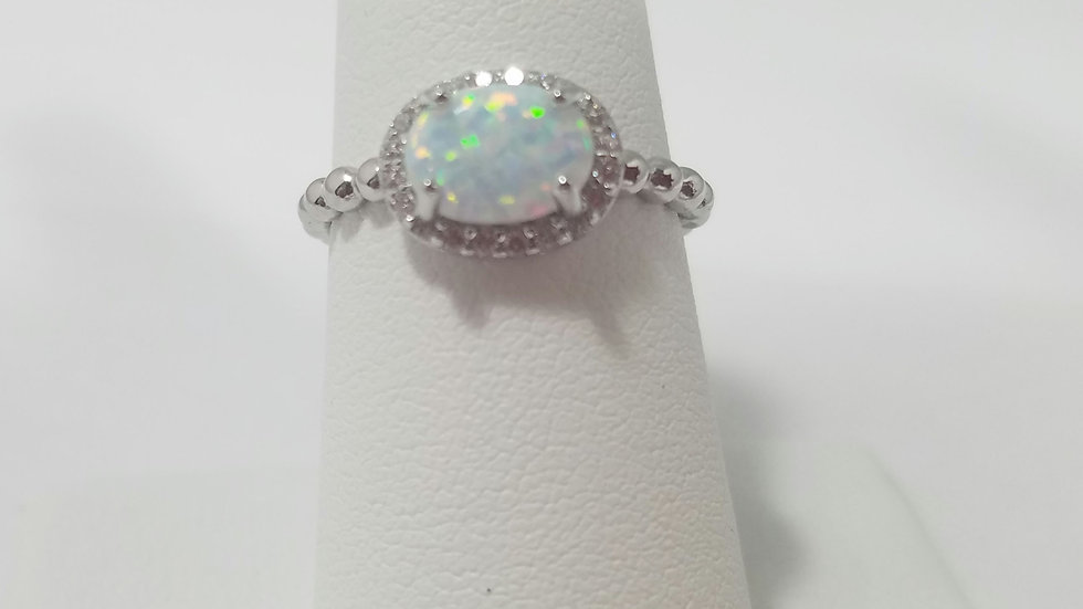 Lab created opal and cz halo sterling silver