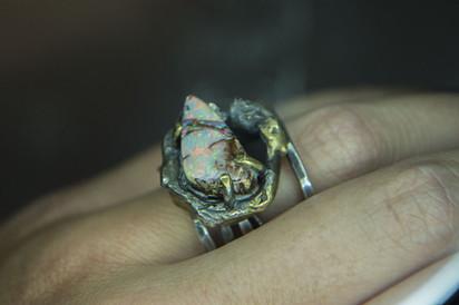 white opal set in a brass bolt