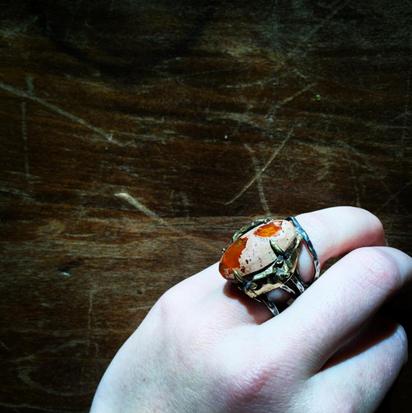 mexican fire opal set in a brass bolt