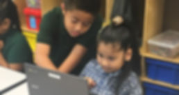 Two PVUSD grade schoolers at laptop.