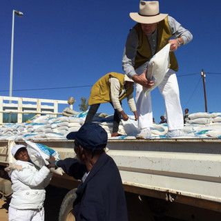 Robert Frazer unloading 10 kg bags of rice to be distributed to the needy.