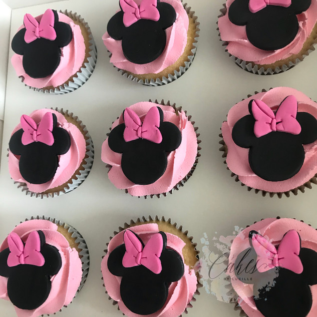 pink rosette buttercream. minnie mouse fondant toppers.