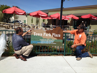 Plaza architect Richard Perlstein & Public Works' Gary Downing install Town Park Plaza sign