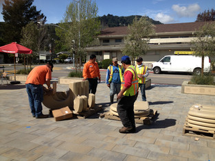 CM Public Works crew assembling concrete tables & benches