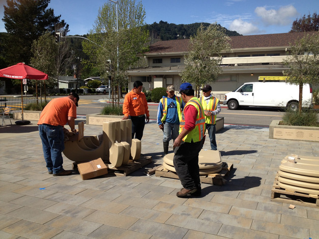 CM Public Works crew assembling concrete tables & benches