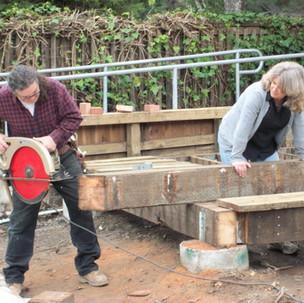 24 Kim Baez trims a beam while Robin Mol