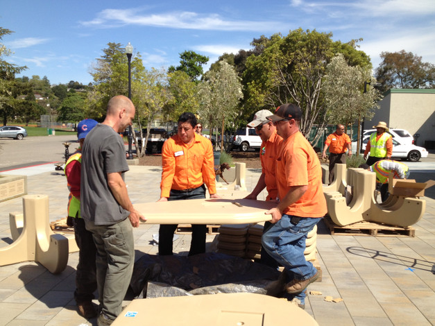 CM Public Works Crew assembling 'indestructible' tables & benches