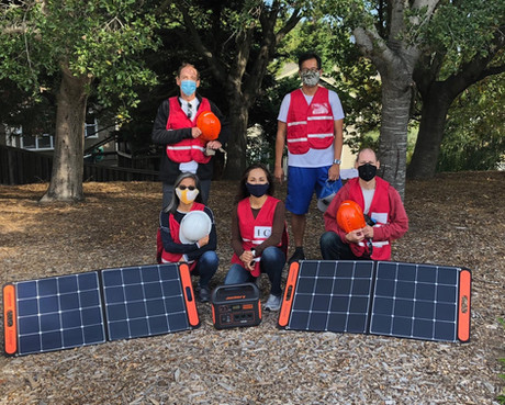 NRG team members with new solar generator & battery