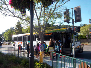 Morning bus stop at Town Park Plaza for