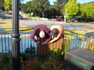 Installing the Town Park Plaza sign
