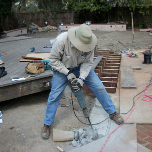 33 Bob Bundy uses a power shovel to brea