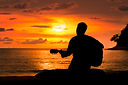 Guitar player at the beach