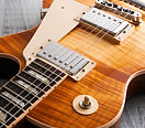 Top Profile of electric Guitar with flame maple top, and special designed pick ups for a unique personal sound