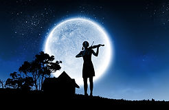 Young girl plays her violin under the moon and starlit night