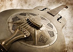 Resonator guitar, widely used in steel, appalachian, bluegrass music