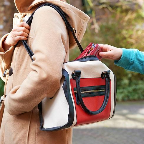 pick-pocket-taking-wallet-542736887-57aa