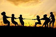 Children pulling rope, tug war, sunset,