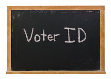 Voter ID written in white chalk on a bla