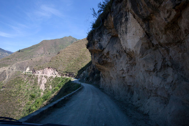 Small one way roads are constructed on the side of the mountain, making traffic dangerous and difficult to pass.