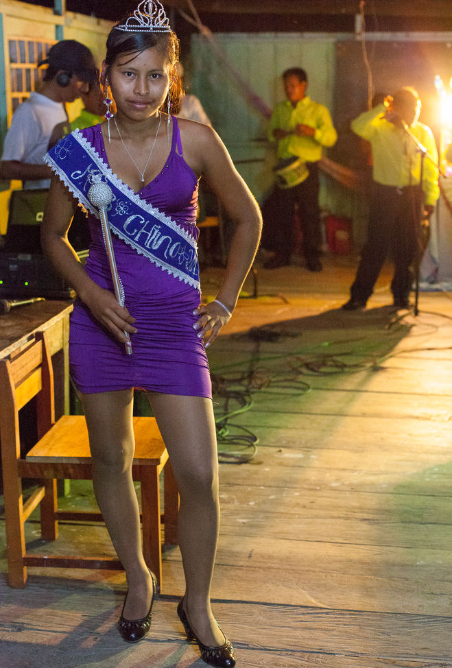 """The winner of a local beauty contest """"Miss Chino"""" poses for a picture in the community hall center."""