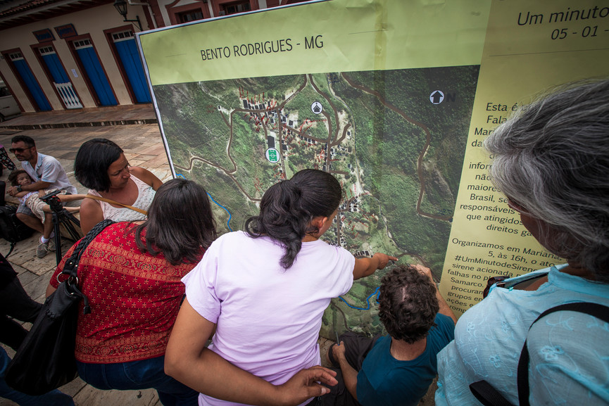 """At """"Um Minuto de Sirene"""" Civilians gather to place their houses on a map placed in Marianas town cneter.   Mariana, Minas Gerais, Brazil."""