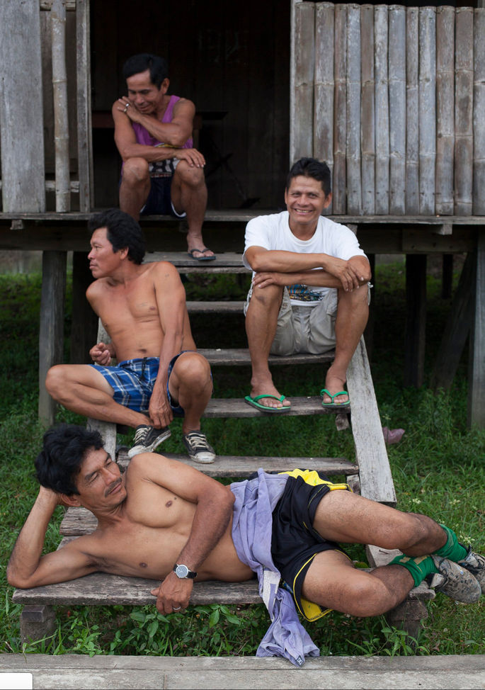 All villages have football teams. These soccer players pose after a game in the village.