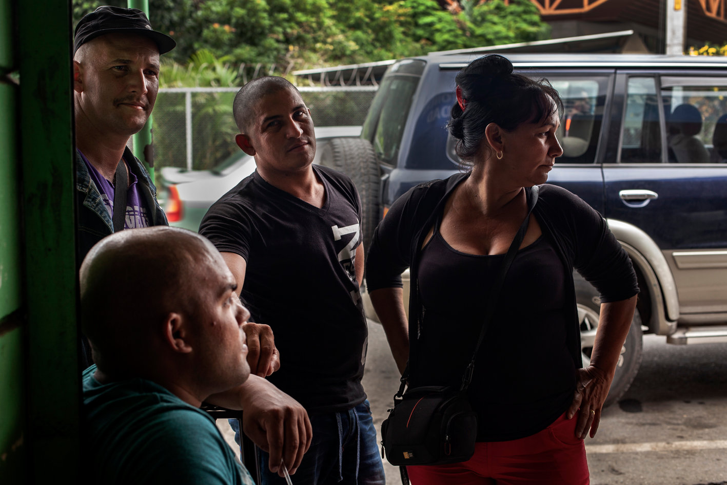A group of cubans wait for a caravan to pick them up near the Carniceria. So far there have been zero arrests for Human smuggling. Usually the caravans don't stop except for gass, and travelers have to take relieve themselves in bottles and boxes they bring along for the ride. They say it can take typically two days to reach Mexico.