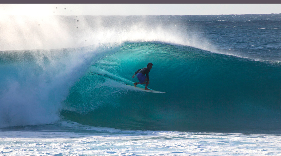 A surfer falls out of a tube in Pipeline, Oahu, Hawaii.
