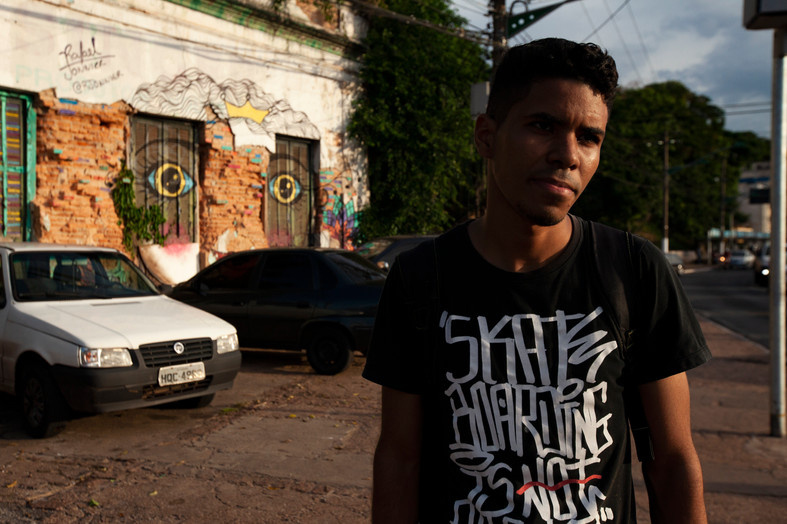 Deivison walks on one of the main streets of the highway in Cuiaba, followed by the eyes of graffiti that run through the city.