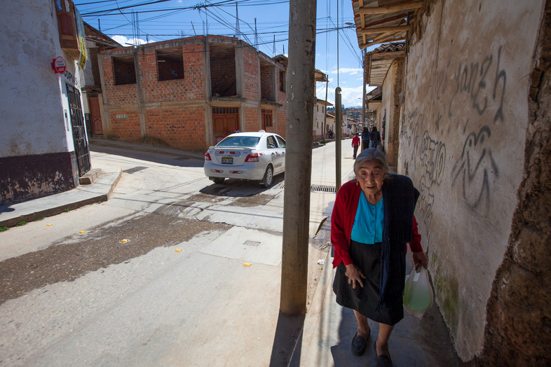 Downtown streets, a woman walks through the streets in Chachapoyas, Peru.