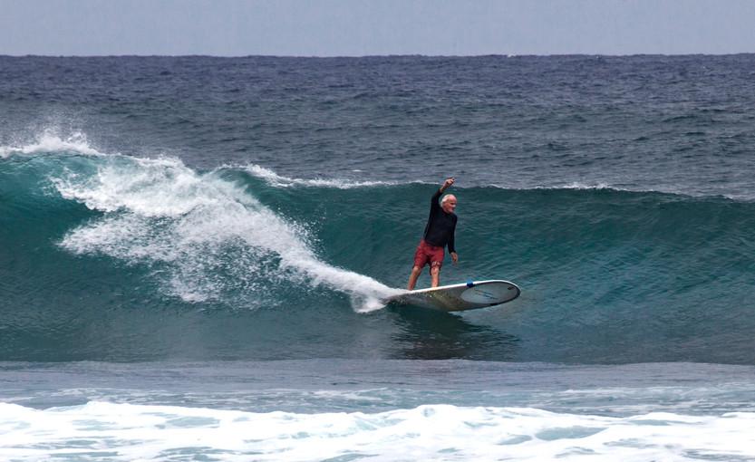 An elder surfer at Lanis spot, North Shore, Hawaii.