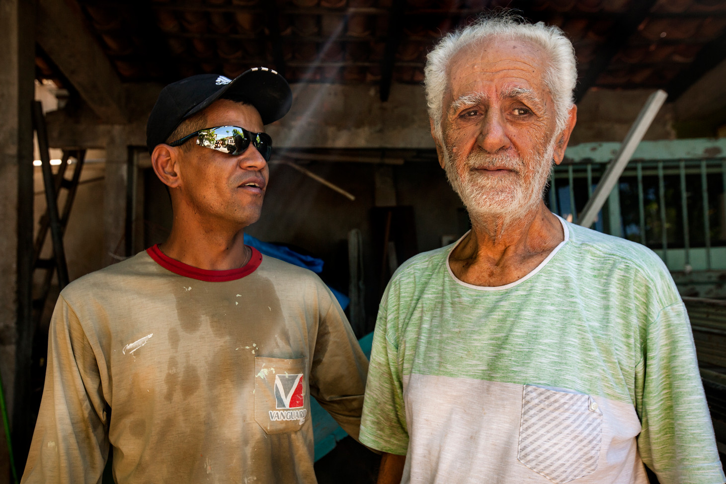 Nilson (Left) speaks with his boss, an immigrant to Brazil from Lebanon. Many immigrants ventured to Brazils interier during the gold rush to escape political distress.