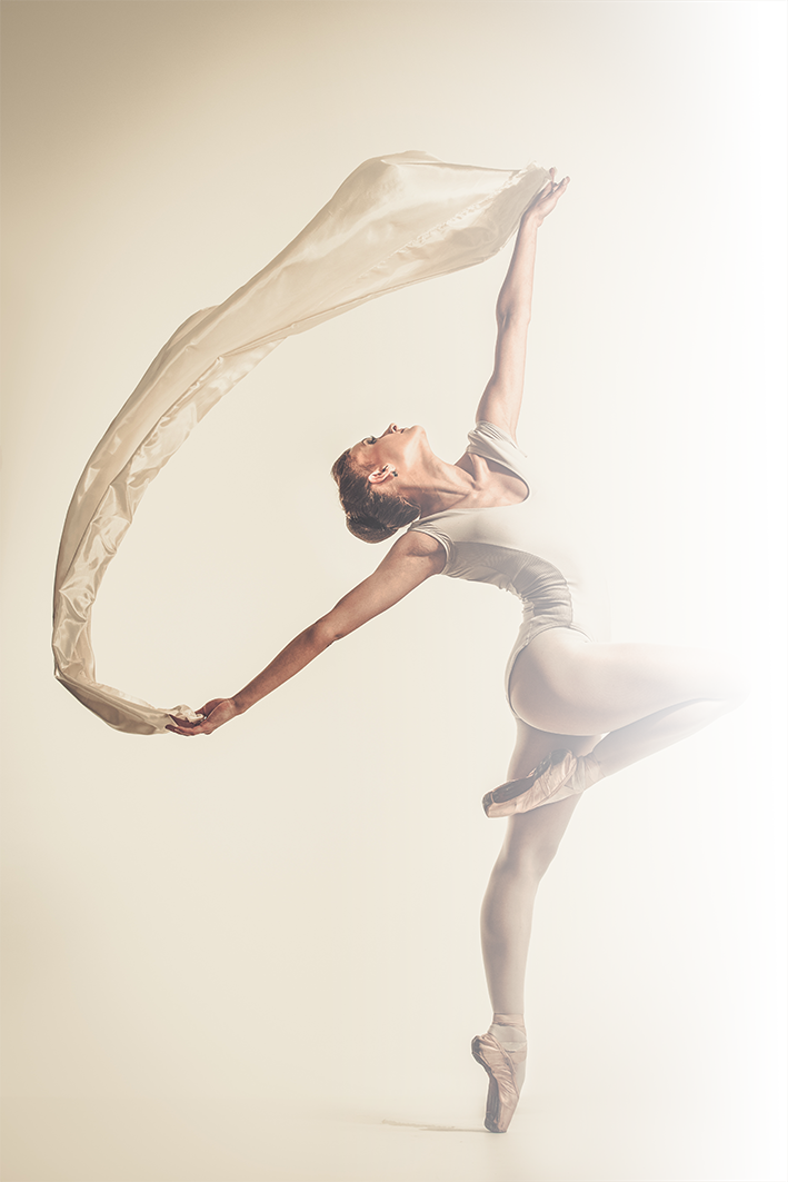 young-ballerina-dancing-with-piece-of-si